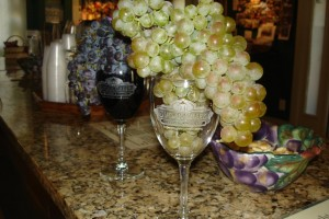 Red and White Grapes on Wine Bar